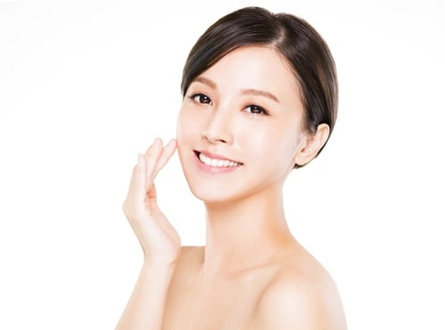 closeup young woman smiling face with clean skin-img-blog